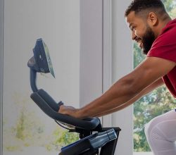 a guy rides a bike for our bowflex c7 and c6 compare